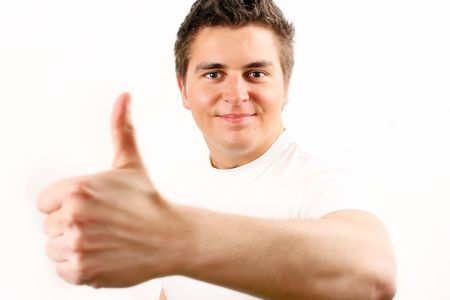 young man in white t-shir showing OK sign photo
