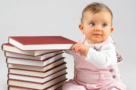 small baby girl and many red books with red cover Stock Photo - 2833488