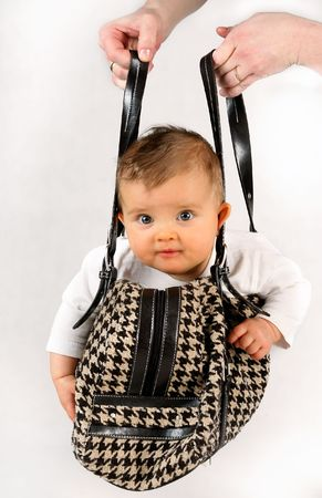 small baby girl in the hanging inside of the bag Stock Photo - 2833501