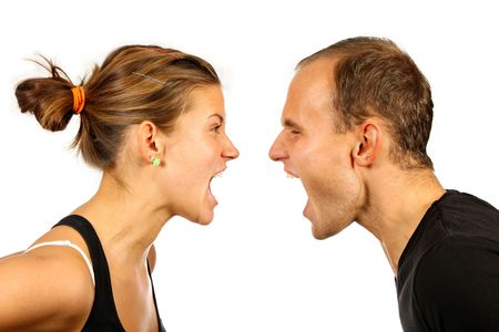 nice young couple screaming at each other photo