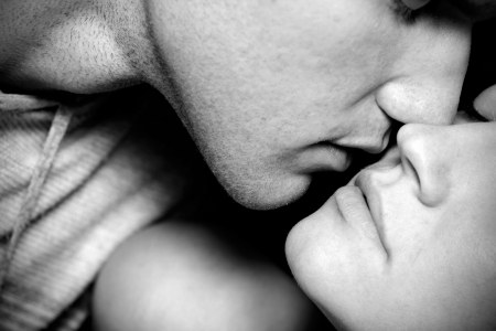 black and white closeup of woman end man kissing photo