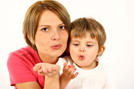 young mother and daughter over white sending kisses Stock Photo - 5974756