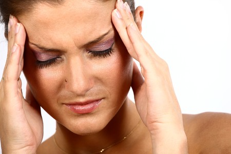 Nice young adult woman with bad headache photo