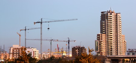 A couple of cranes on the construction site, nigt shot photo