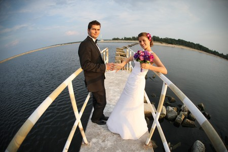A picture of young married couple over the sea view and beach photo