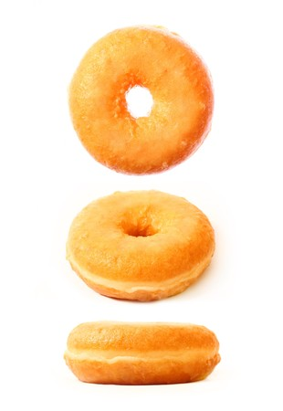 A picture of three glazed donuts in different positions over white background photo