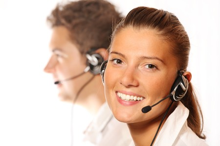 contact center: A picture of a team of young call center workers, pretty woman in the foreground