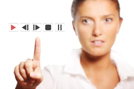touch button: A picture of a young pretty businesswoman touching the button over white background