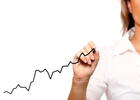 A picture of a businesswoman drawing a chart over white background photo