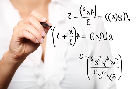 A picture of a young teacher solving a mathematical equation over white background Stock Photo - 8083007