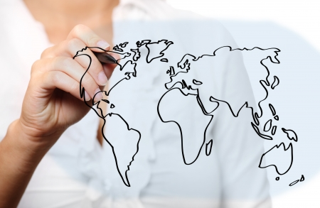 A picture of a young woman drawing a world map over white background Stock Photo - 8083008