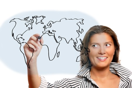 A portrait of a young beautiful woman drawing a world map over white background Stock Photo - 8083024