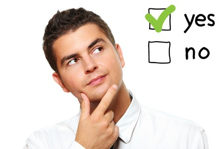 A portrait of a young businessman voting for yes over white background Stock Photo - 8083045