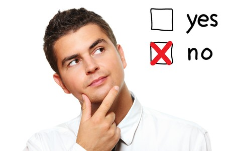 A portrait of a young businessman voting for no over white background Stock Photo - 8083046