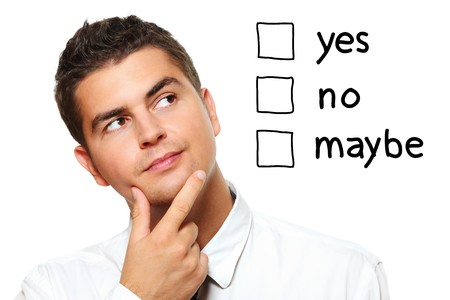 A portrait of a young businessman choosing from three options yes no maybe over white background Stock Photo - 8083047