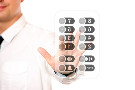 number button: A picture of a young businessman touching the elevator panel over white background