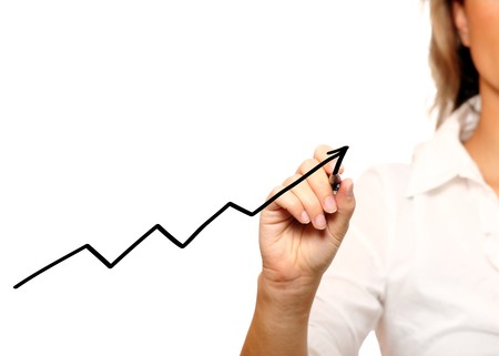 A picture of a businesswoman writing a graph over white background photo