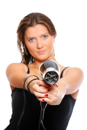 A portrait of a young beautiful woman with a hair dryer which looks like a gun photo