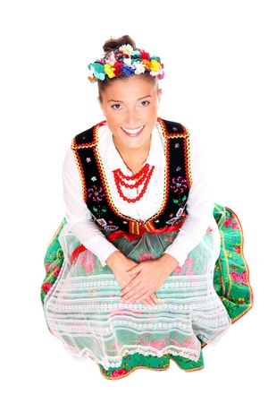 A portrait of a beautiful Polish girl in traditional clothes sitting over white background Stock Photo - 8165726