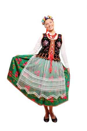 traditional dress: A portrait of a Polish woman in traditional outfit over white background Stock Photo