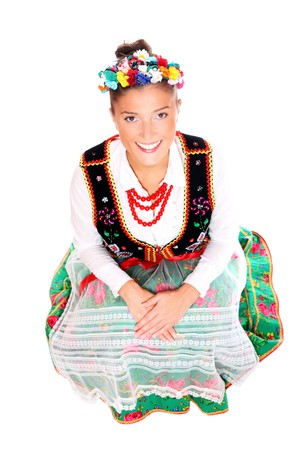 A portrait of a beautiful Polish girl in traditional clothes sitting over white background Stock Photo - 8165727
