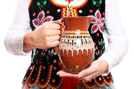 A close-up of a jug over traditional Polish outfit Stock Photo - 8165735