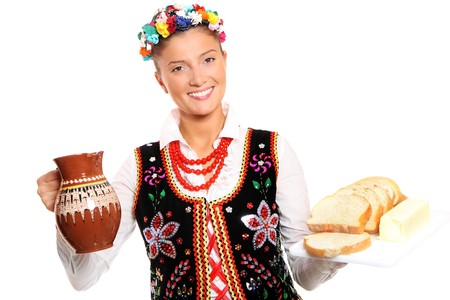 A portrait of a beautiful and hospitable Polish woman in a traditional outfit photo