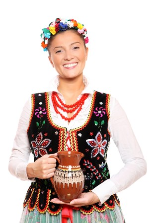 A portrait of a beautiful and hospitable Polish woman in a traditional outfit Stock Photo - 8165738