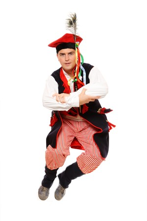 A close-up of a Polish traditional dancer dancing over white background Stock Photo - 8240414