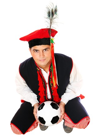 A picture of a Polish man in a traditional outfit with a football symbolizing Euro Cup 2012 over white background photo