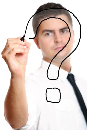 Young businessman drawing a big question mark over white background Stock Photo - 8240422