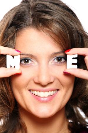 e pretty: Pretty woman holding letters m and e close to her face