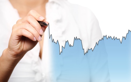 A portrait of a businesswoman drawing a chart over white background photo