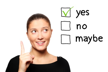 A portrait of a young woman voting for yes over white background Stock Photo - 8407124