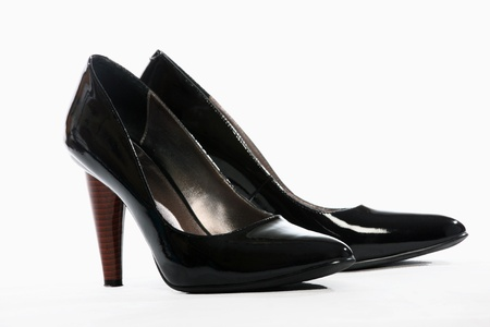 black heels: A picture of a pair of black heels over white background