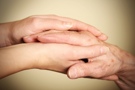 two hands: A picture of old and young hands symbolizing help and love
