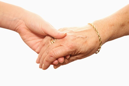 mature old generation: A picture of a young and an old hand over white background
