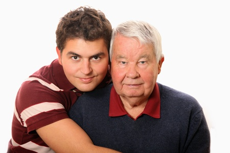 A portrait of a granson standing with his grandpa against white background