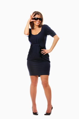 A portrait of a sexy woman standing over white background photo