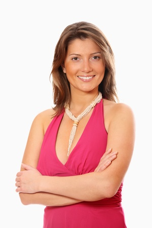 A portrait of a pretty confident woman in a pink dress standing over white background photo