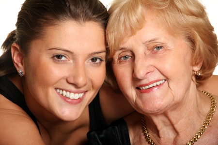 grandmother grandchild: A portrait of a granddaughter hugging her grandma over white background