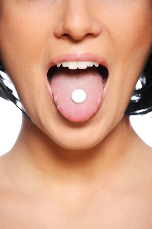 girl tongue: A picture of a female tongue with a white tablet on it Stock Photo