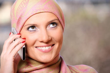 A portrait of a successful arabic woman talking on the cell phone photo