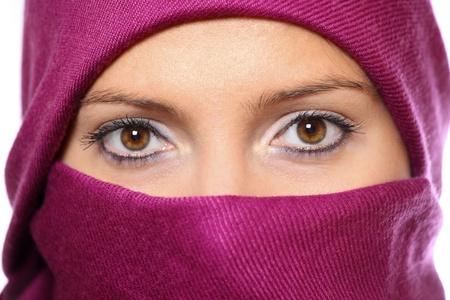 head scarf: A portrait of an arabic woman face hidden behind a purple scarf