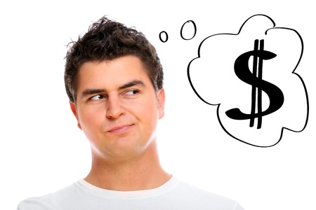 A portrait of a handsome man dreaming about money over white background Stock Photo - 8817065