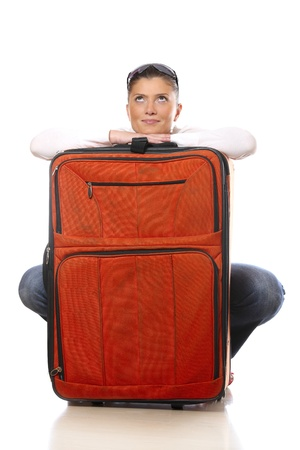 A picture of a young woman with an orange big suitcase ready to go on holidays photo