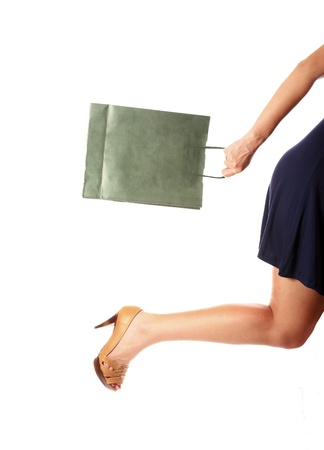 A picture of a sexy woman running on heels to a shop over white background photo