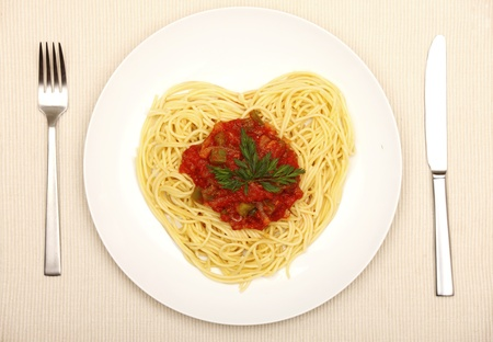A picture of fresh spaghetti in the shape of a heart for Valentines day photo