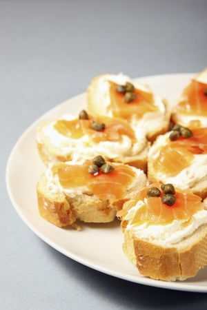 A close-up of traditional jewish sandwiches with cream cheese, salmon and capparis photo