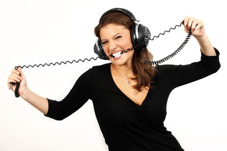 sound bite: A picture of a young girl listening to music, dancing and biting a wire over white background